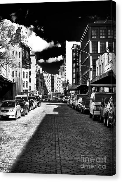 Shadows On The Street Canvas Print by John Rizzuto