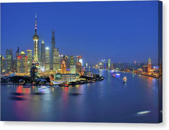 Shanghai Cityscape Across Huangpu River Canvas Print by Wei Fang