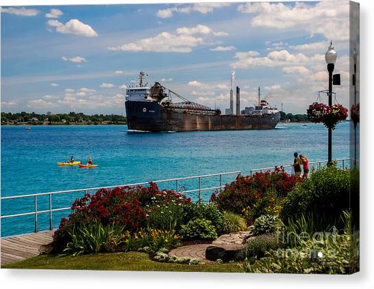 Ship And Kayaks Canvas Print