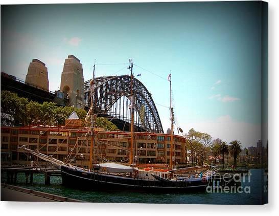 Ship Under Sydney Bridge Canvas Print by John Potts