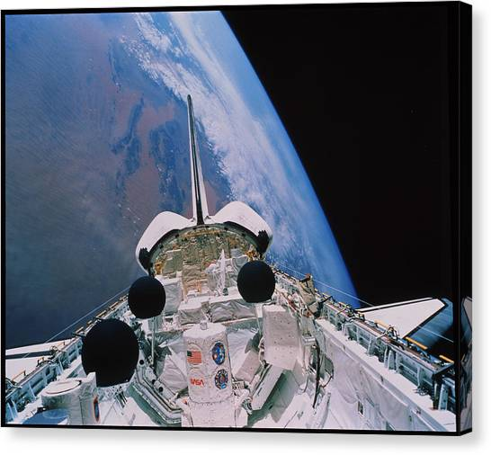 Space Shuttle Canvas Print - Shuttle In Orbit by Nasa/science Photo Library