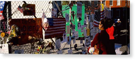 Chain Link Fence Canvas Print - Side Profile Of A Woman Standing by Panoramic Images