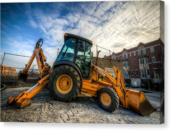 Backhoes Canvas Print - Side View Of A Backhoe At Sunset by Anthony Doudt