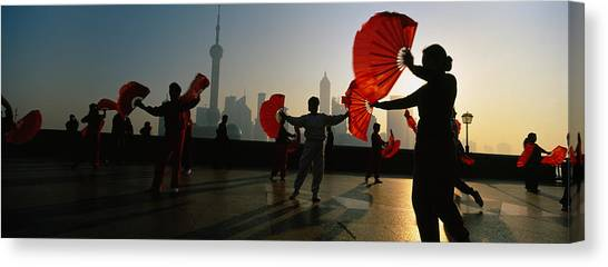 Bund Canvas Print - Silhouette Of A Group Of People Dancing by Panoramic Images