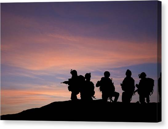 Nato Canvas Print - Silhouette Of Modern Troops In Middle East Silhouette Against Be by Matthew Gibson