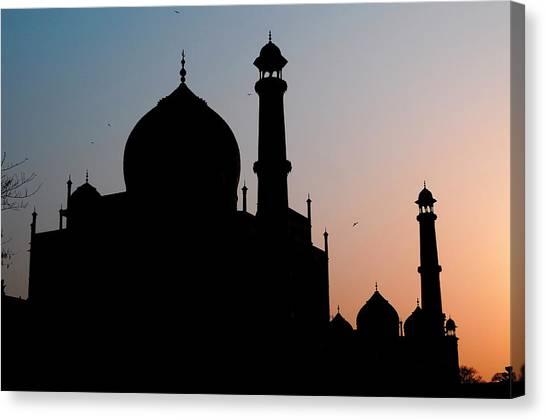 Silhouette Of The Taj Mahal At Sunset Canvas Print by Steve Roxbury