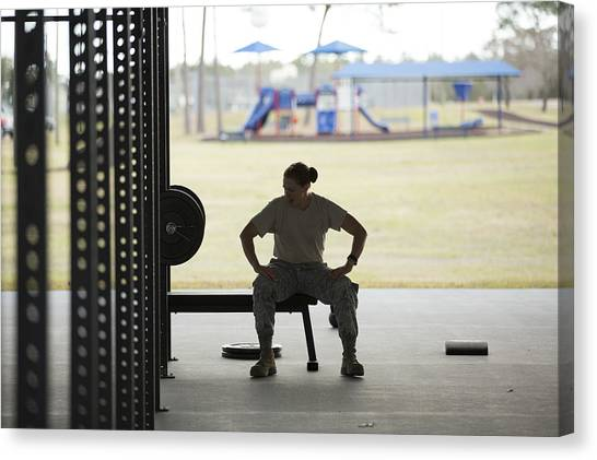 Silhouetted Female Soldier Barbell Training At Air Force Military Base Canvas Print by Sean Murphy