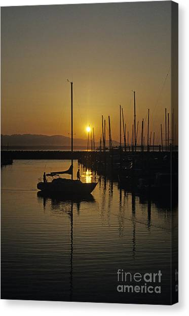 Silhouetted Man On Sailboat Canvas Print