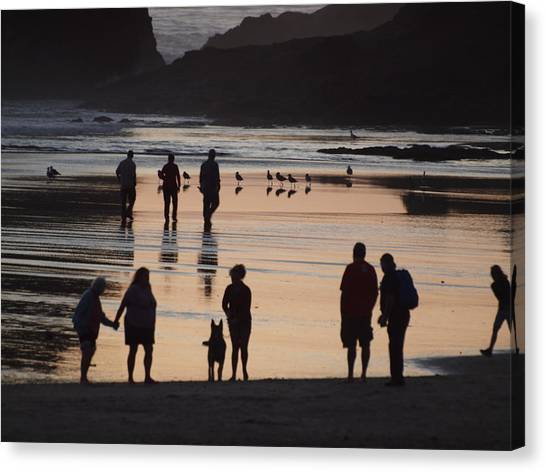 Silhouettes On The Beach Canvas Print