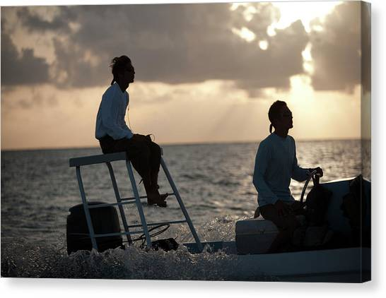 Belize Canvas Print - Sillouetted Man Steers Flats Boat by Chris Ross