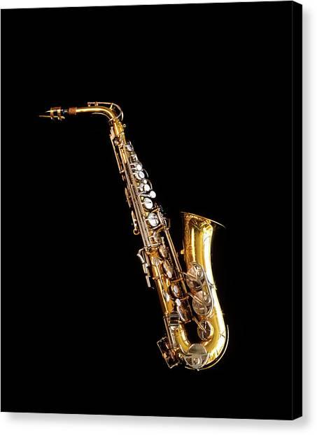 Wind Instruments Canvas Print - Single Saxophone Against Black by Vintage Images