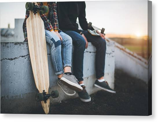Skateboarders Taking A Rest In Skate Park Canvas Print by Hobo_018