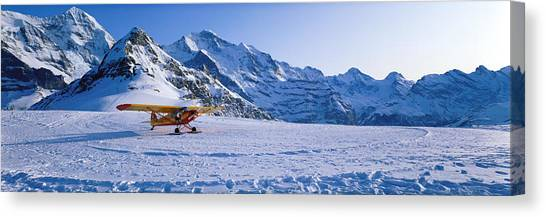 Prop Planes Canvas Print - Ski Plane Mannlichen Switzerland by Panoramic Images