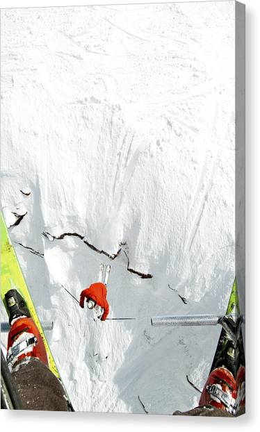 Skier Jumps Off Cliff Under Chairlift Canvas Print by Connor Walberg