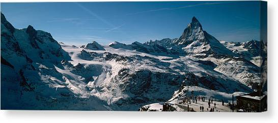 Matterhorn Canvas Print - Skiers On Mountains In Winter by Panoramic Images