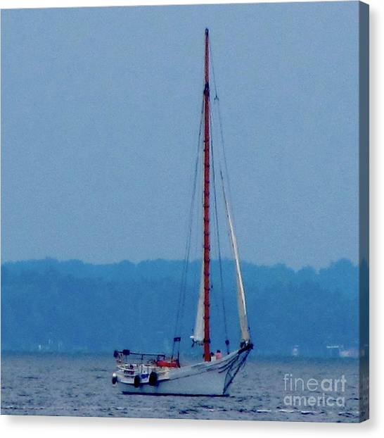 Skipjack Mast Lowering On The Bay Canvas Print by Debbie Nester