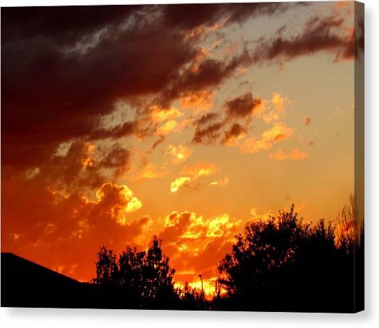 Sky On Fire. Canvas Print by Joyce Woodhouse