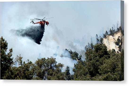 Skycrane Canvas Print - Skycrane Dropping Load Of Fire Retardant by Jeff Lowe