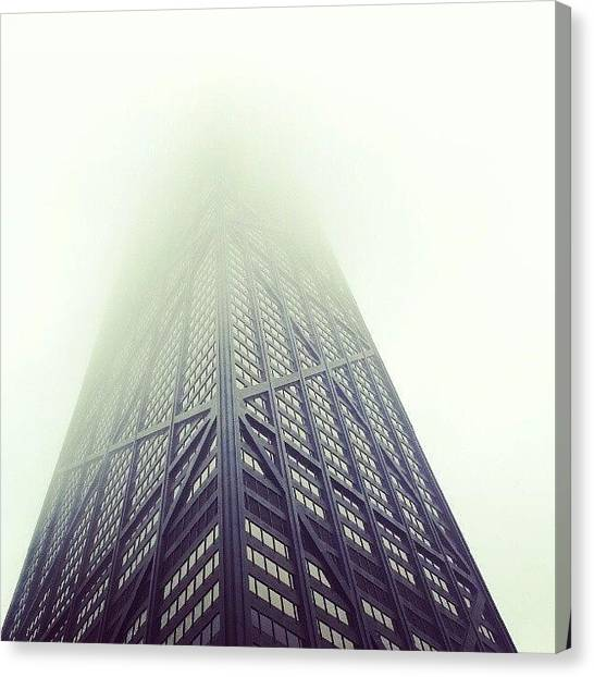 Skyscrapers Canvas Print - Skyscraper On A Foggy Day by Jill Tuinier