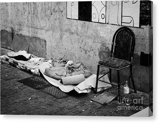 sleeping rough on the streets of Santiago Chile Canvas Print by Joe Fox