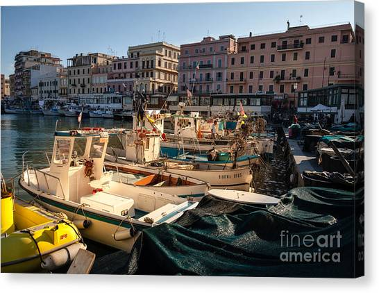 small working fishing boats moored stern first in Anzio harbour Canvas Print