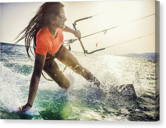 Smiling Young Female Kiteboarder On The Sea Canvas Print by Vm