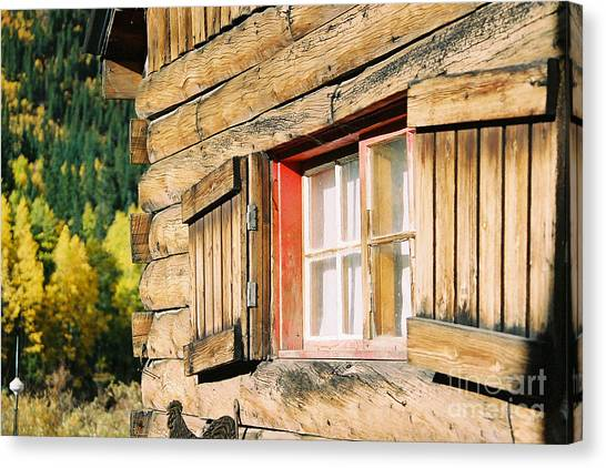 Snow Cabin Window Canvas Print