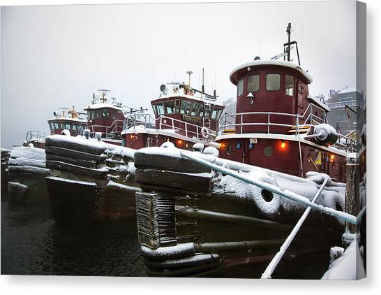 Snow Covered Tugboats Canvas Print