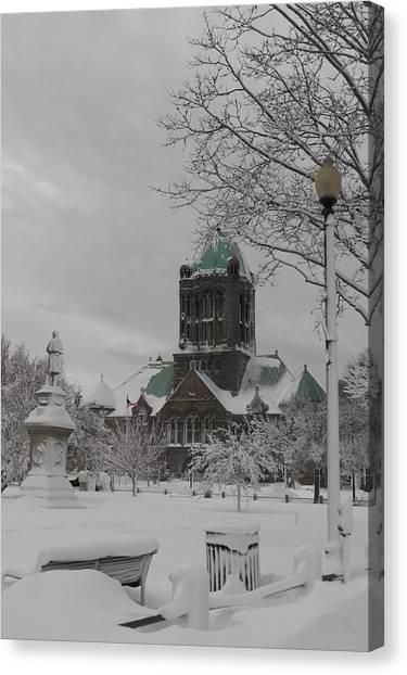 Snow Draped Green Canvas Print