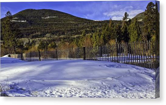 Snow Fence Fall River Road Canvas Print by Tom Wilbert
