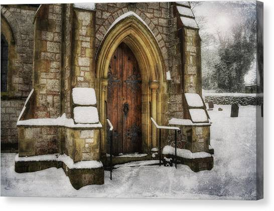 Snowy Church Door Canvas Print
