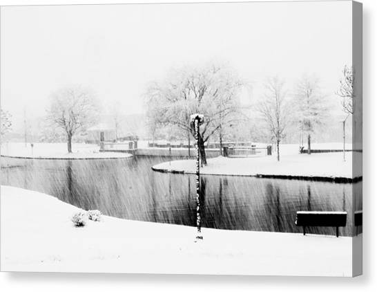 Snowy Day On Man Made Pond Canvas Print