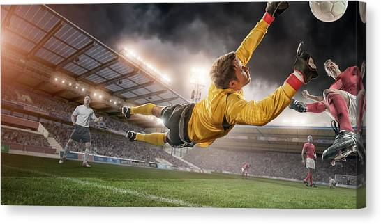 Soccer Goalie In Mid Air Save Canvas Print by Peepo