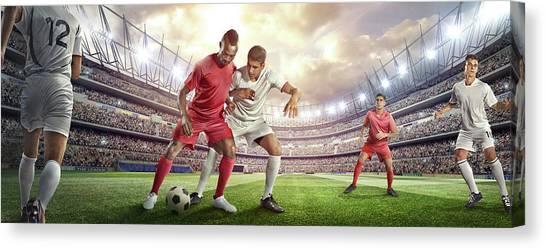 Soccer Player Tackling Ball In Stadium Canvas Print by Dmytro Aksonov