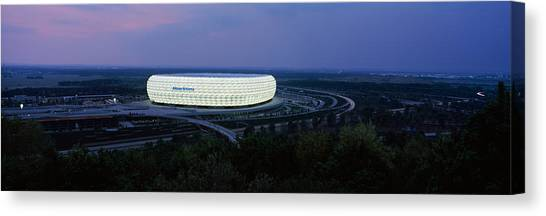 Fc Bayern Munich Canvas Print - Soccer Stadium Lit Up At Nigh, Allianz by Panoramic Images