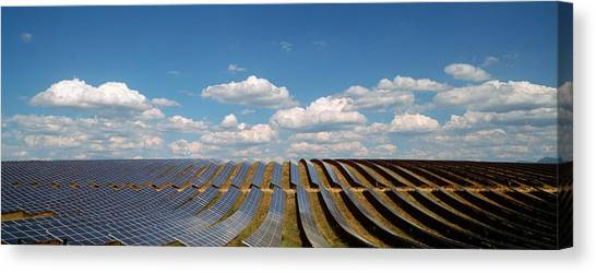 Clean Energy Canvas Print - Solar Panels In A Field by Panoramic Images