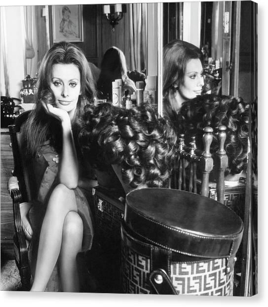 Chin Canvas Print - Sophia Loren With A Fendi Hat Box by Henry Clarke