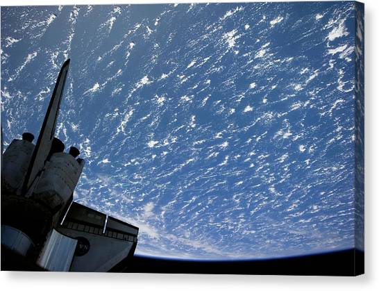 Space Shuttle Canvas Print - Space Shuttle And Earth by Nasa/science Photo Library