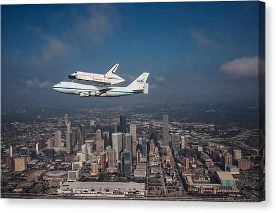 Space Shuttle Canvas Print - Space Shuttle Endeavour Over Houston Texas by Movie Poster Prints