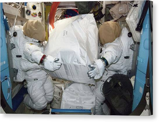 Emus Canvas Print - Spacesuits On The Iss by Nasa
