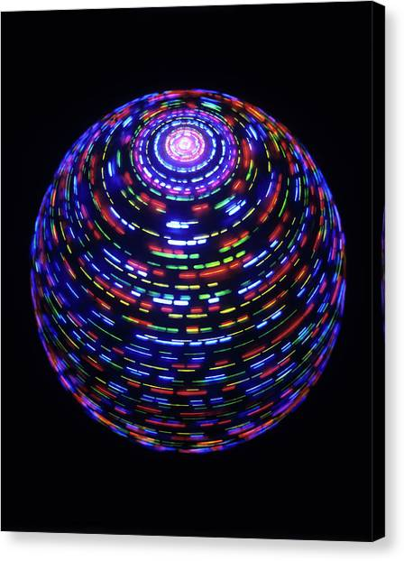 Fast Ball Canvas Print - Spinning Globe by Lawrence Lawry
