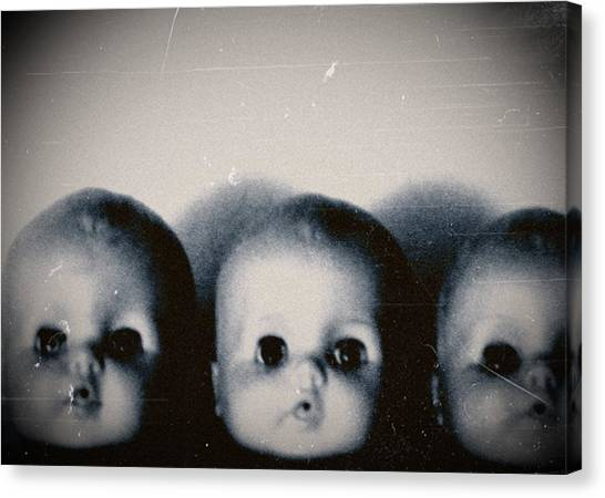 Spooky Doll Heads Canvas Print