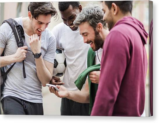 Sports Guys With Smart Phone Having Fun Canvas Print by Hinterhaus Productions