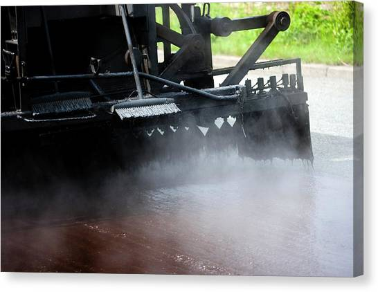 Spraying Bitumen During Road Resurfacing Canvas Print by Ian Gowland/science Photo Library