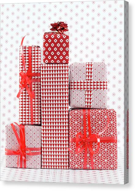 Stack Of Wapped Gifts Canvas Print by Muriel De Seze