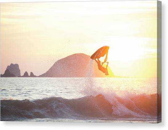 Jet Skis Canvas Print - Stand Up Jet Ski Backflip At Sunset by Marcos Ferro