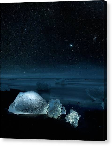 Starry Night Over Ice On Black Sand Canvas Print by Arctic-images