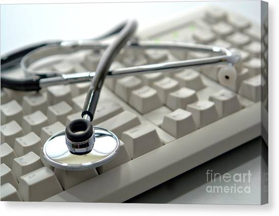 Electronic Instruments Canvas Print - Stethoscope On Computer Keyboard by Olivier Le Queinec