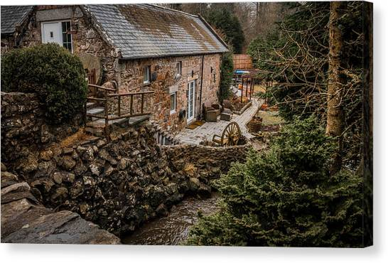 Stone Home By The Stream Canvas Print