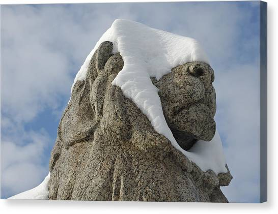 Stone Lion Covered With Snow Canvas Print by Matthias Hauser